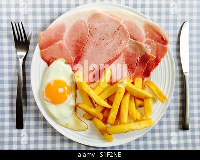 Ham, fried egg and chips - Stock Photo