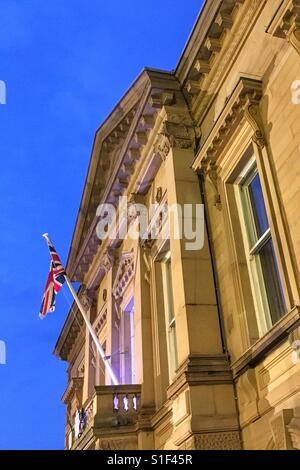 Union Jack flag flying on Batley Town Hall - Stock Photo