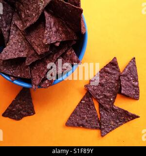 Blue tortilla chips in a bowl - Stock Photo
