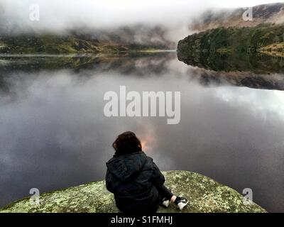 Contemplation looking into the distance - Wicklow mountains , Ireland - Stock Photo