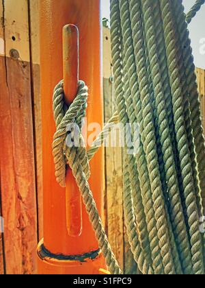 Bow line rope tied to a securing cleat on the Staten Island ferry, NYC, USA - Stock Photo