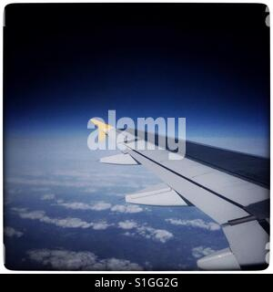 The view from seat 19A on a Monarch Airways flight from Leeds Bradford Airport, UK. - Stock Photo