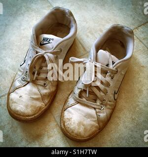 Old dirty worn-out running shoes - Stock Photo
