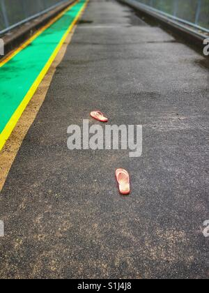 Lost flip flops on a bridge, - Stock Photo