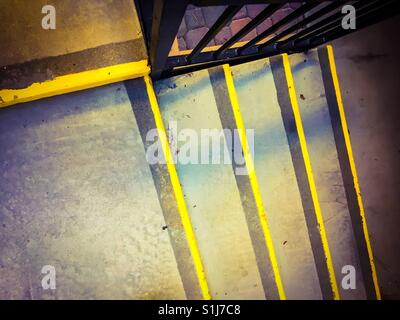 Colorful stairway with yellow safety strips on steps - Stock Photo