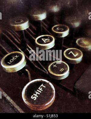 The Shift key and other keys of a qwerty keyboard on an old fashioned typewriter. - Stock Photo