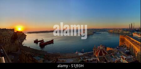 Sunrise over Valletta harbour in Malta. - Stock Photo