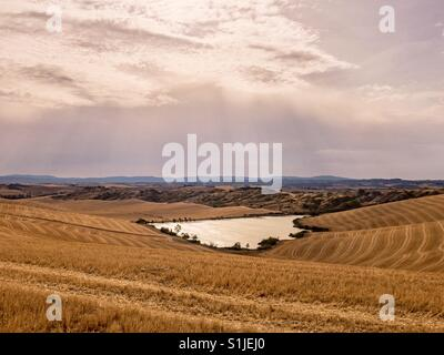 Scenic view of the Tuscan countryside near Siena in summer. - Stock Photo