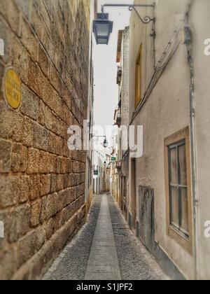 Typical narrow  street in Lisbon, Portugal. - Stock Photo