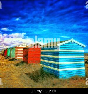Colourful beach huts in Littlestone Kent. - Stock Photo