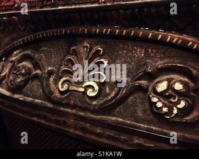 Shell and scroll detail on fireplace insert- North Carolina - Stock Photo