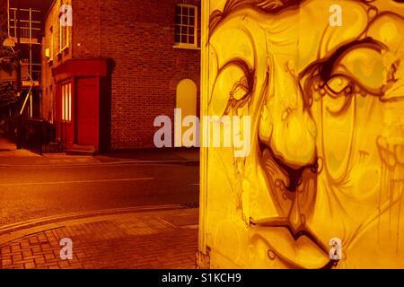 Satirical street art portrait man on wall in Brixton London UK - Stock Photo
