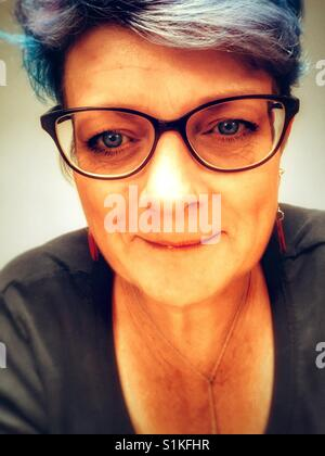 50-year old woman wearing spectacles - Stock Photo