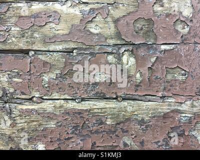 Peeling brown paint on an old wooden door. Suitable for backgrounds etc. - Stock Photo