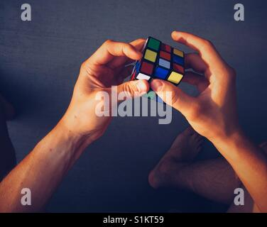 Rubik's Cube being solved. Point of view shot. Space for copy. - Stock Photo