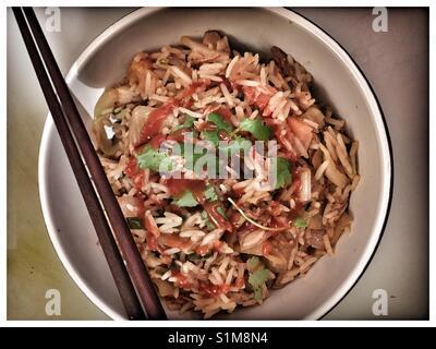 Pork Rib, Peanut and Vegetable fried rice with Sriracha. - Stock Photo