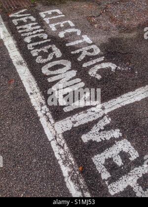Parking space for electric cars in London, England - Stock Photo