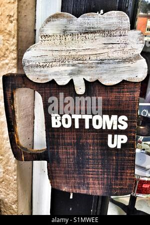 Bottoms up beer sign. - Stock Photo