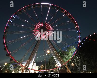 Torquay, in Devon, UK using the colours of Barcelona for their big wheel, to stand shoulder to shoulder with the - Stock Photo