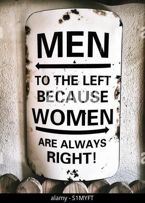 A sign saying: men to the left because women are always right - Stock Photo