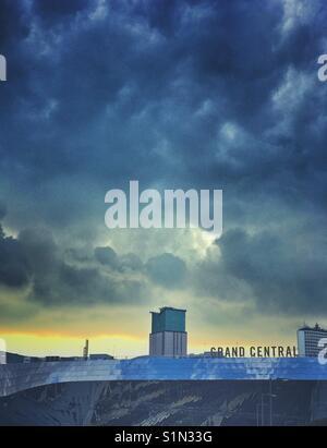 Dark clouds over Grand Central Train Station, Birmingham, UK - Stock Photo