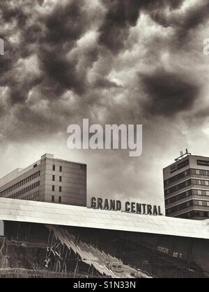 Dark clouds over Grand Central Station, Birmingham, UK - Stock Photo