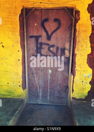 I love you jesus stock photo 310881877 alamy i love jesus writing and drawing on a door in a rural village in pemba altavistaventures Gallery