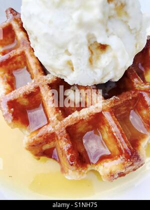 Sticky toffee Belgian waffle with ice cream - Stock Photo