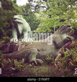 Stone dinosaurs in Crystal Palace park - Stock Photo