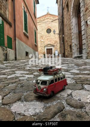 Trip concept with a car miniature - Stock Photo