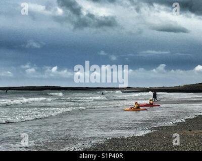 Surf kayaks on Broad Beach, Rhosneigr, North Wales, Anglesey - Stock Photo