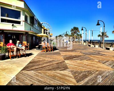 Oceanfront boardwalk and shops, Myrtle Beach, South Carolina - Stock Photo