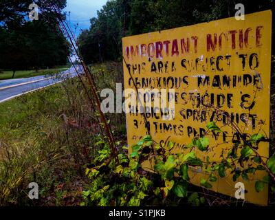 Fair warning by the road- farmer's notice to potential land developers - Stock Photo