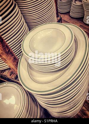 Ceramic plates stacked on display in Fish's Eddy,NYC,USA - Stock Photo