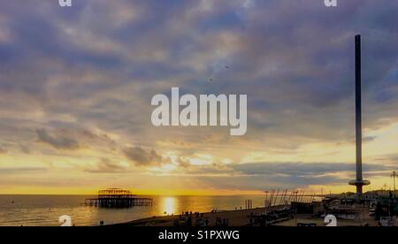 Sunset on Brighton beach - Stock Photo