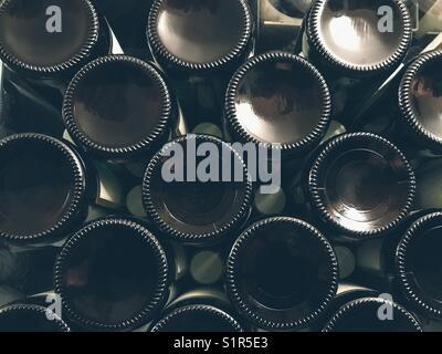 Wine bottles in a cellar - Stock Photo
