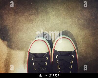 Selfie of black sneakers - Stock Photo