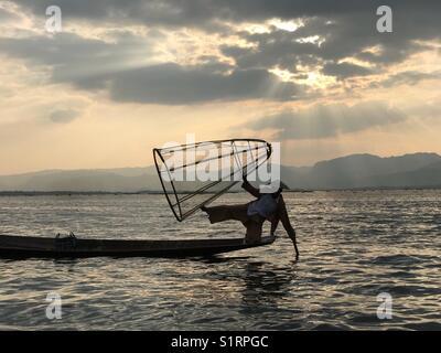 Myanmar fisherman in Inle Lake, Myanmar - Stock Photo