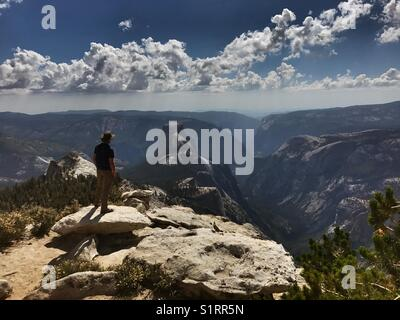 Clouds Rest is a mountaintop that gives a grand view into Yosemite Valley and Half Dome. - Stock Photo