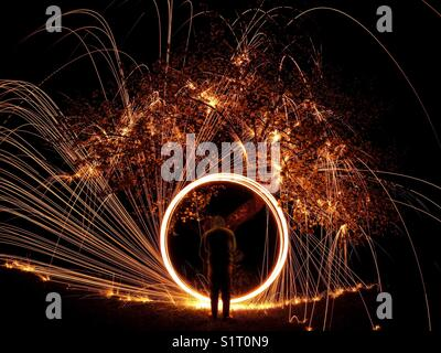 Steel wool spinning apple tree - Stock Photo