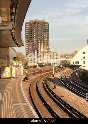 Shell of burnt out tower block Grenfell tower from platform of Wood Lane underground station - Stock Photo
