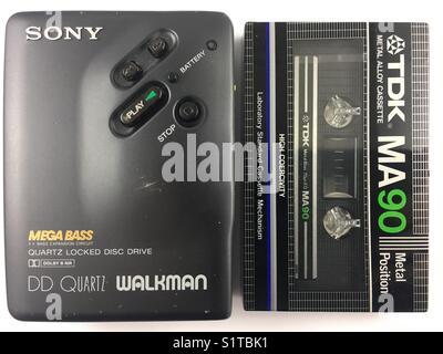 Sony cassette Walkman alongside a TDK metal cassette tape. - Stock Photo