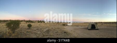 Isolated campsite in the vastness of the Australian Simpson Desert - Stock Photo