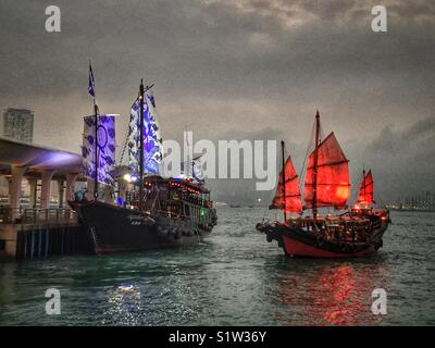 'Duk Ling' and 'Aqualuna II', replica Chinese junks, transport tourists for sightseeing cruises on Victoria Harbour, - Stock Photo