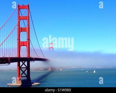 Fog belt over Golden Gate bridge. - Stock Photo