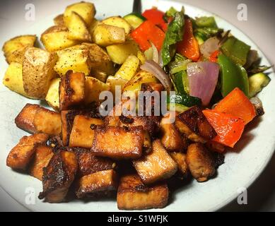 A vegan meal of tofu and grilled vegetables. - Stock Photo