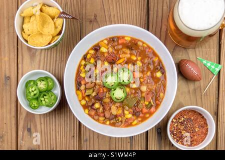 Super Bowl Chili with beer and corn chips - Stock Photo