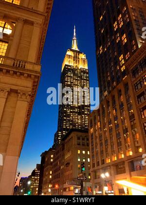 View of the Empire State building from Fifth Avenue at dusk, New York City, USA - Stock Photo