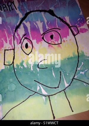 Child's drawing of a smiling person with colorful face