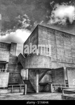 A person climbing the stairs at the National Theatre, London, England, UK. - Stock Photo